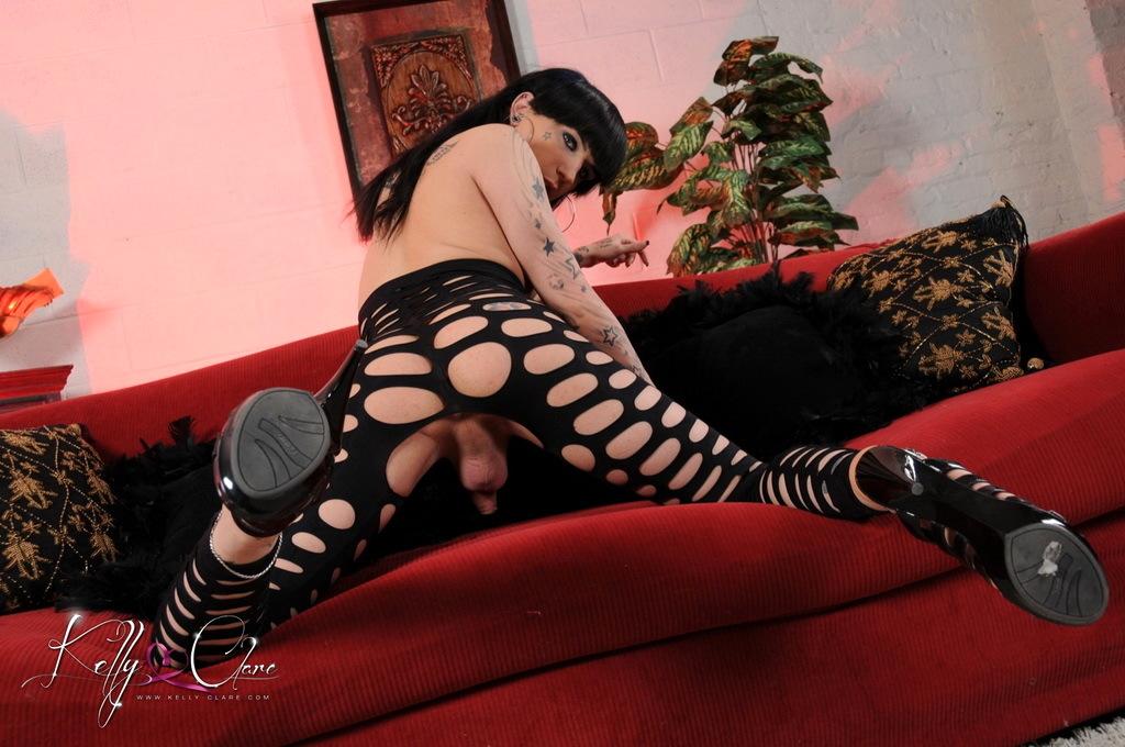 Arousing Kelly Plays In Net Cat Suit
