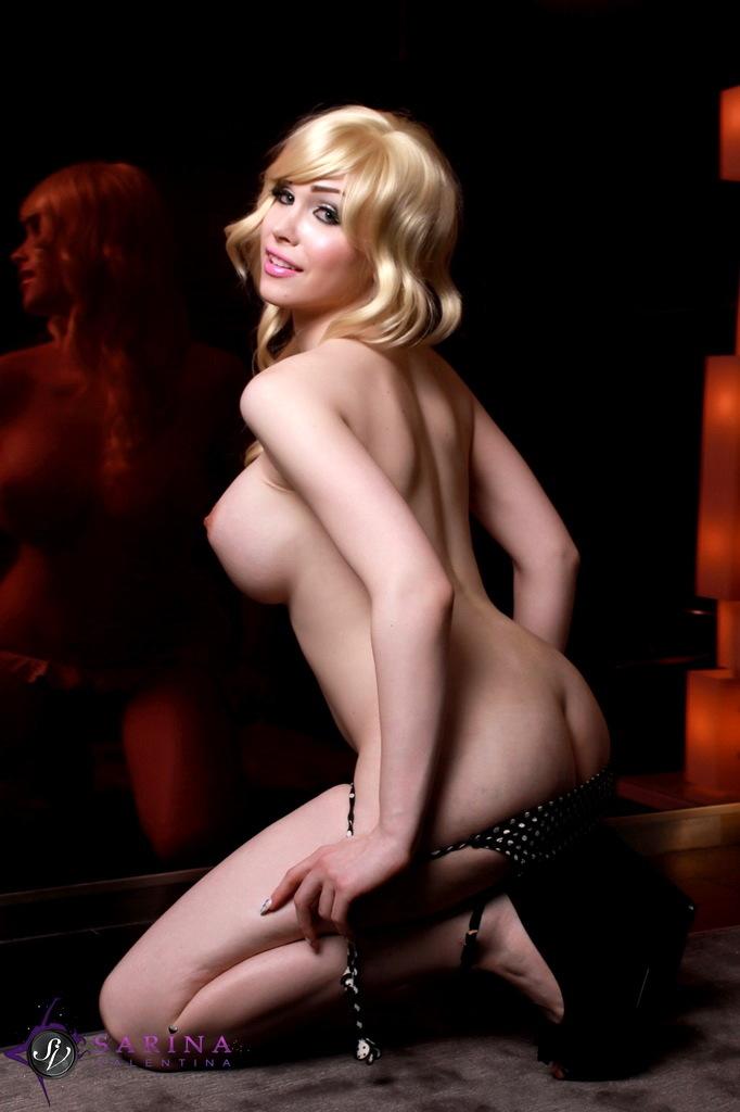 Busty Sarina Posing Her Smoking Steamy Body