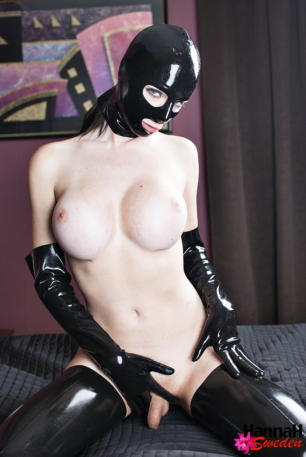 Enormous Boobs Submissive T-Girl In Black Hood