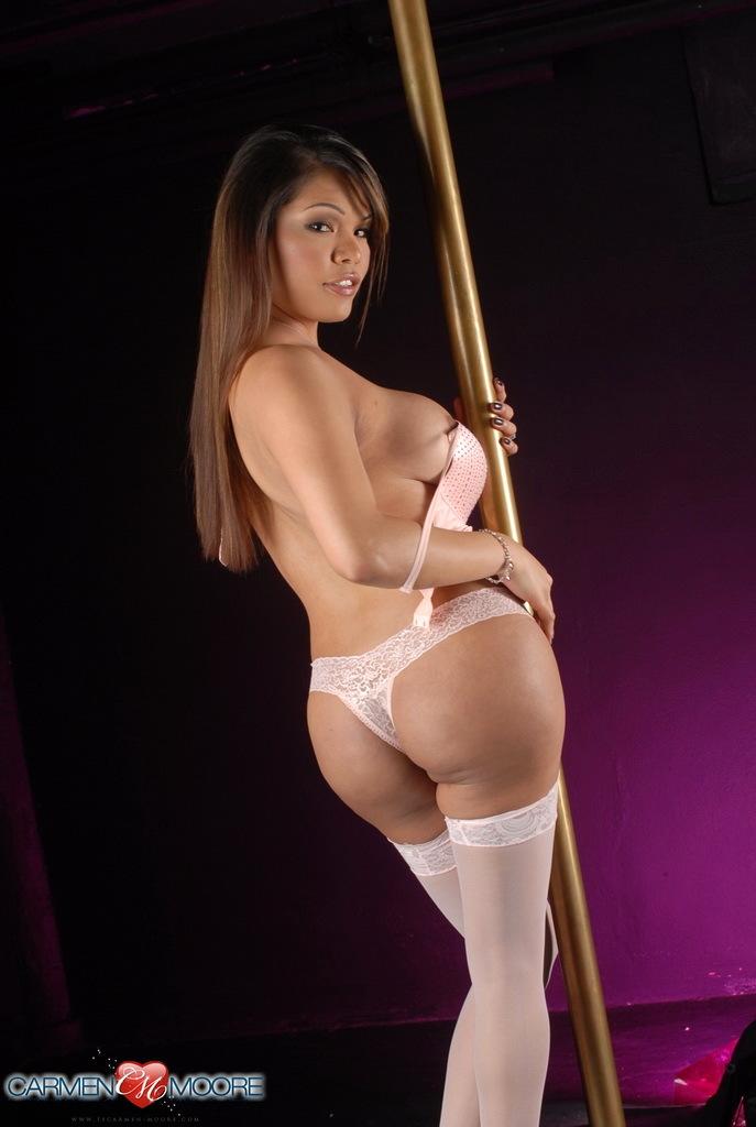 Flirtatious Carmen Poses Pole Dances